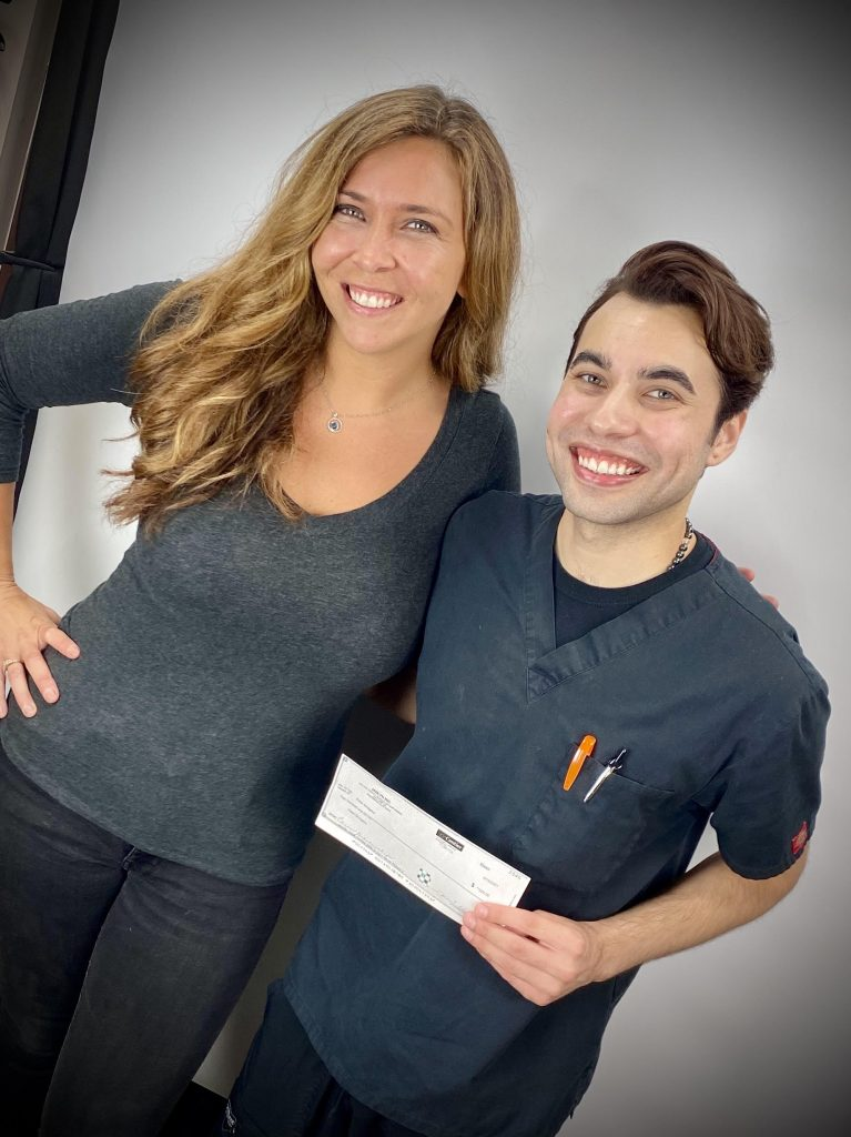 Salon owner and student posing for scholarship award picture
