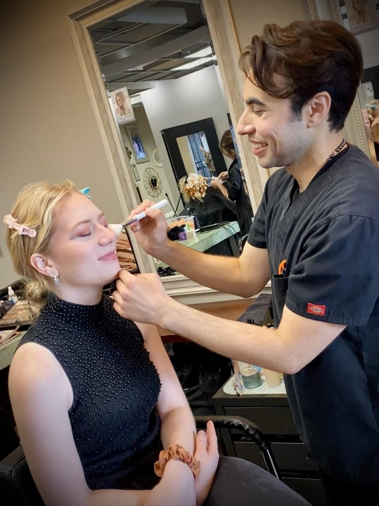 Makeup artist working with a client